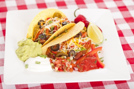 Beef tacos with lettuce cheese and tomato 免版税图像