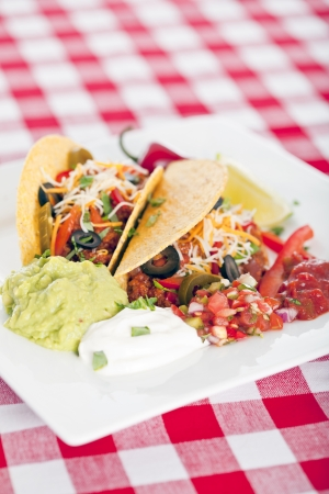 ground beef: Beef tacos with lettuce cheese and tomato Stock Photo