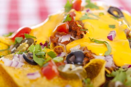 Plate of fresh nachos with a spicy jalapeno cheese sauce