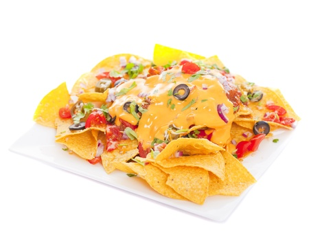 NACHO: Plate of fresh nachos with a spicy jalapeno cheese sauce