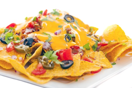 nachos: Plate of fresh nachos with a spicy jalapeno cheese sauce