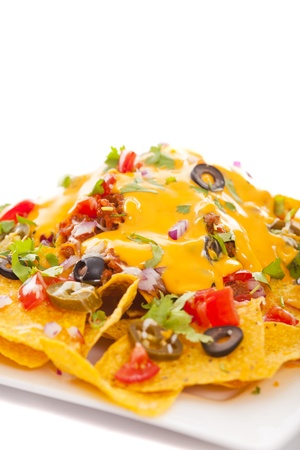 Plate of fresh nachos with a spicy jalapeno cheese sauce  免版税图像