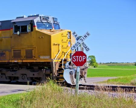 A speeding train crossing a road in rural America 免版税图像