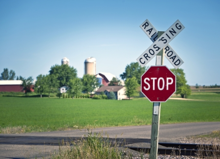 Railroad crossing and stop sign in farmland Stock Photo - 15803110