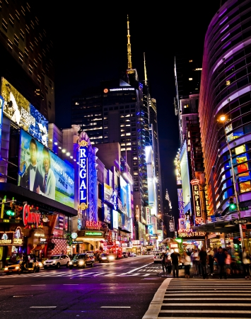 NEW YORK CITY - JUNE 3: Times Square is a busy tourist intersection of neon art and commerce and is an iconic street of New York City and America, June 3rd, 2012 in Manhattan, New York City.  免版税图像 - 15792471