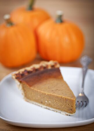 pumpkin pie: Slice of pumpkin pie on a wooden table