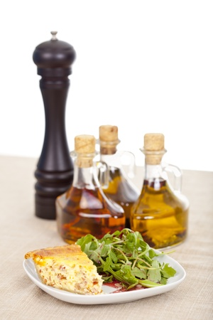 Fresh baked slice of quiche lorraine on a plate 免版税图像