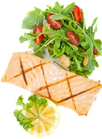 Fresh cooked salmon fillet with arugula salad