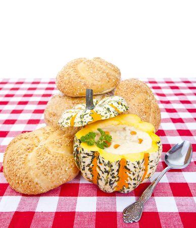 Fresh clam and chicken chowder in a pumpkin bowl