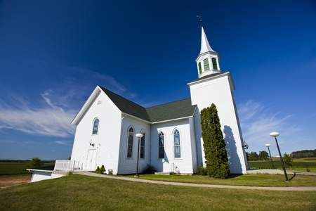 Traditional American white church in the countryside photo