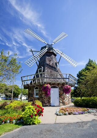 Beautiful windmill surrounded by flowers in the summer