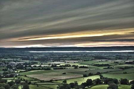 severn: Elevated view over the river Severn, rolling fields with countryside in Gloucestershire Stock Photo