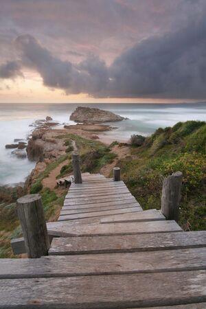 A path leading to the edge of the sea Standard-Bild