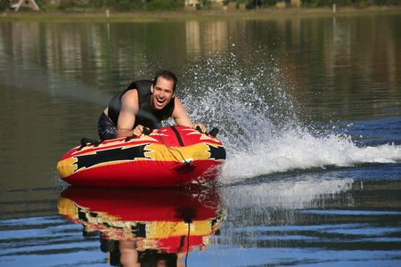 water skiing: tubing behind a boat Stock Photo