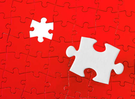 cardboard background: Jigsaw pieces with a red background