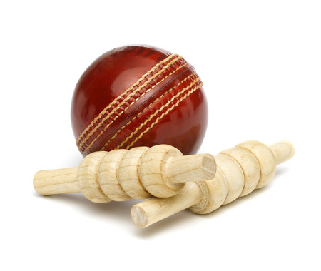 Red Leather Cricket Ball with Bailes photo