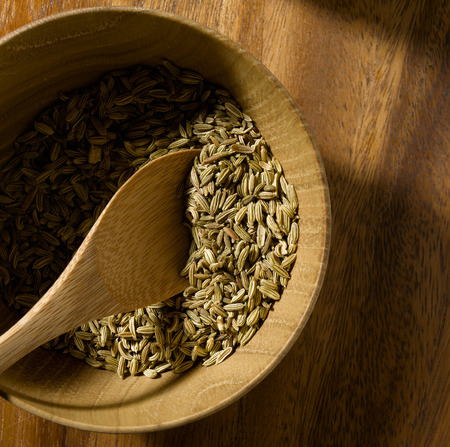 fennel seed: Fennel Seed a wooden background Stock Photo