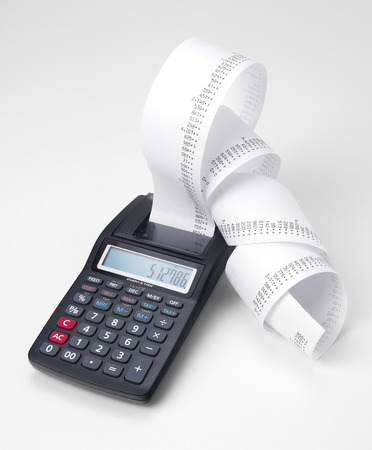 Calculator with roll of adding machine tape