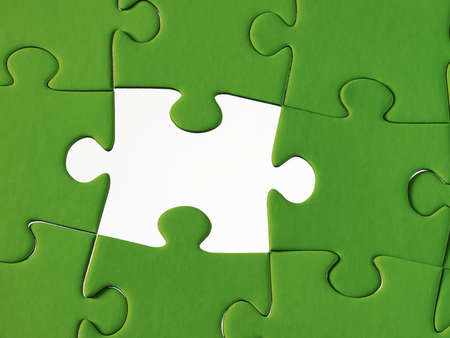 Jigsaw pieces with a gren background photo
