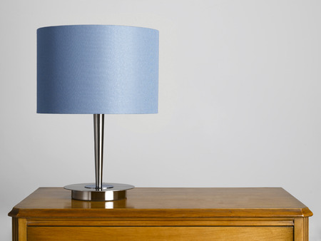Lampshade on sideboard Stock Photo
