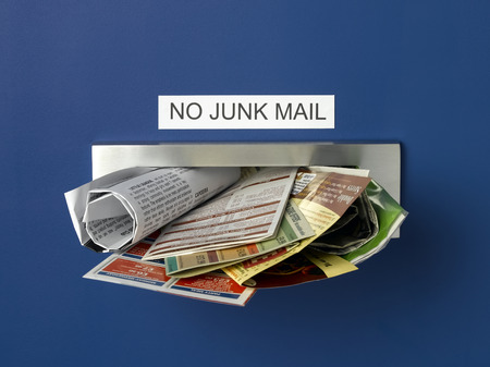 Junk Mail Letterbox Stock Photo