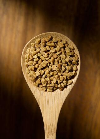 methi: Fenugreek seed on spoon