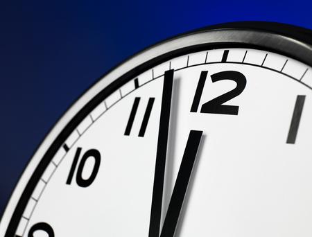 12 o'clock: Close up clock face at 12 O