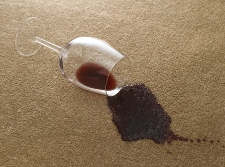 red wine stain: Glass of red wine on carpet