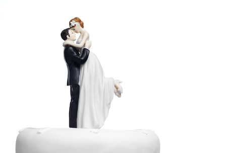 bride and groom background: Bride and Groom on a wedding cake Stock Photo