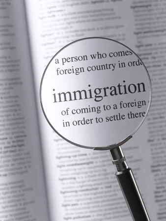 thesaurus: Magnifying Glass Highlighting Immigration