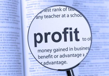 Making a Profit word in closeup shot  photo