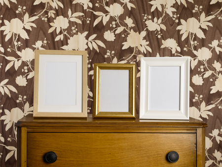 Blank picture frames at home Stock Photo