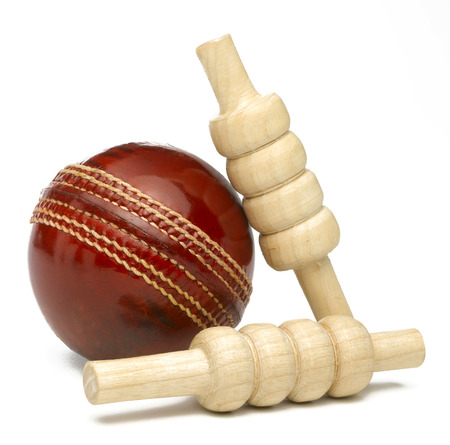 Cricket ball and bailes isolated on white