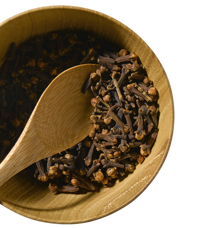 Cloves in bowl isolated on white photo