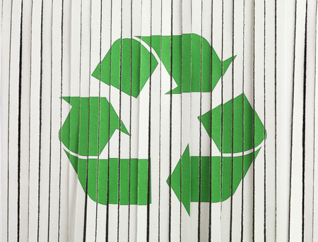 proprietary: Shredded Paper with a recycle sign Stock Photo