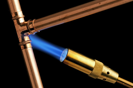 blowtorch: Blowtorch with flame on a black background Stock Photo