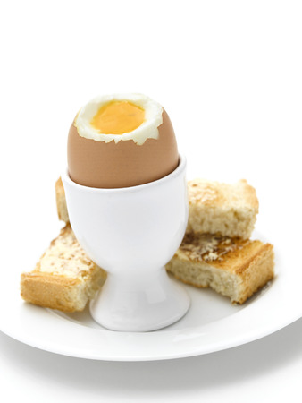 Boiled Egg and toast on white photo