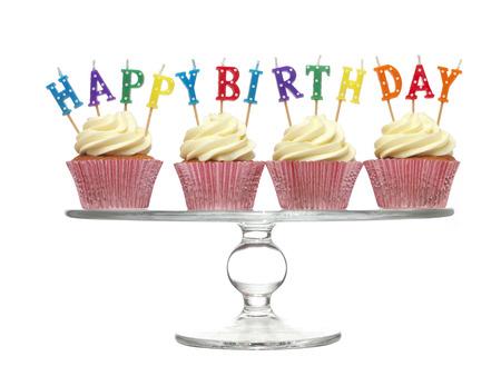 birthday cupcake: Cupcake with happy birthday candles