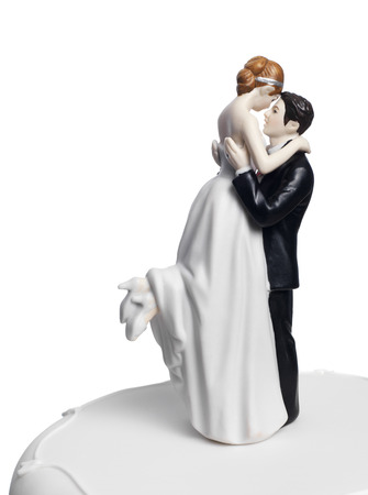 out of engagement: Bride and Groom on a wedding cake Stock Photo