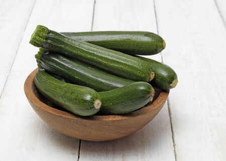 courgettes: Fresh Courgettes on table top