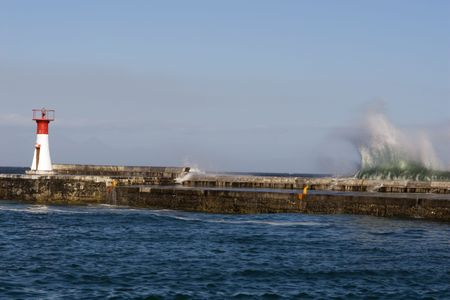 pounding: Waves pounding the harbour wall. Kalk Bay , South Africa Stock Photo