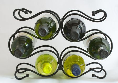 A wine rack holding six bottles Stock Photo - 2505450