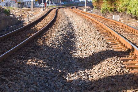 Railway tracks and power lines Stock Photo