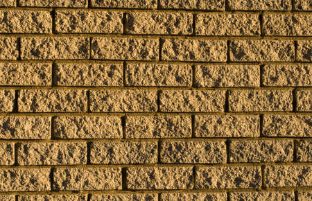 The patterns created by the bricks in a facebrick wall Stock Photo