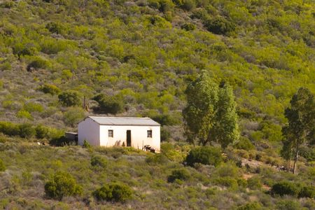 Farmworkers cottage on the hillside Stock Photo