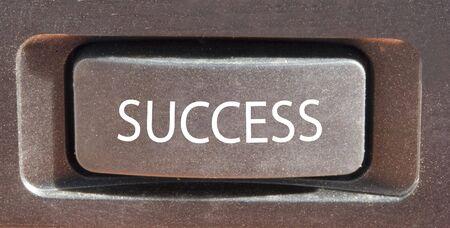 Closeup of a button marked success Stock Photo