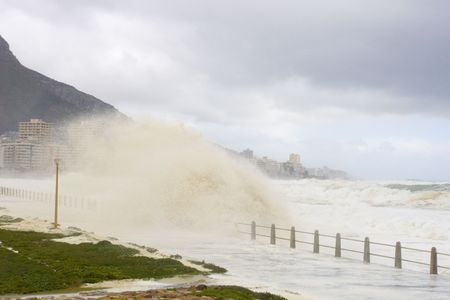 Rough seas crash against the beachfront during a storm. Cape Town, South Africa