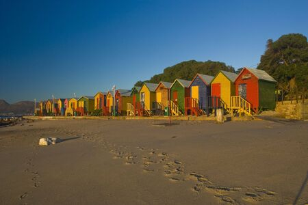 A row of brightly colored beach huts. Taken at St James, South Africa Stock Photo