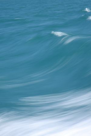 The motion of the waves provides an abstract backdrop in this close up picture of the sea