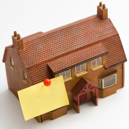 Miniature house model with a blank note attached with a pin. Stock Photo - 1353293